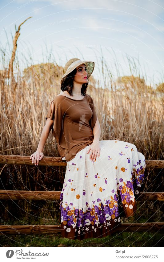 Stylish woman Lifestyle Style Beautiful Human being Woman Adults Nature Landscape Fashion Clothing Skirt Hat Brunette Sit Eroticism Cute Retro Brown girl young