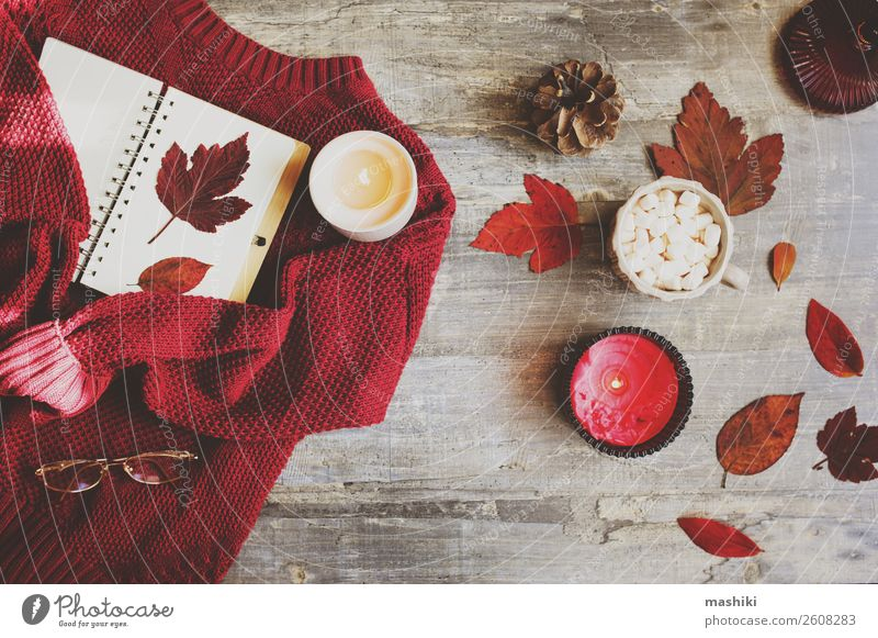 cozy autumn flat lay with red knitted sweater Lifestyle Winter Decoration Desk Table Nature Autumn Leaf Paper Candle Write Creativity note fall Seasons notebook