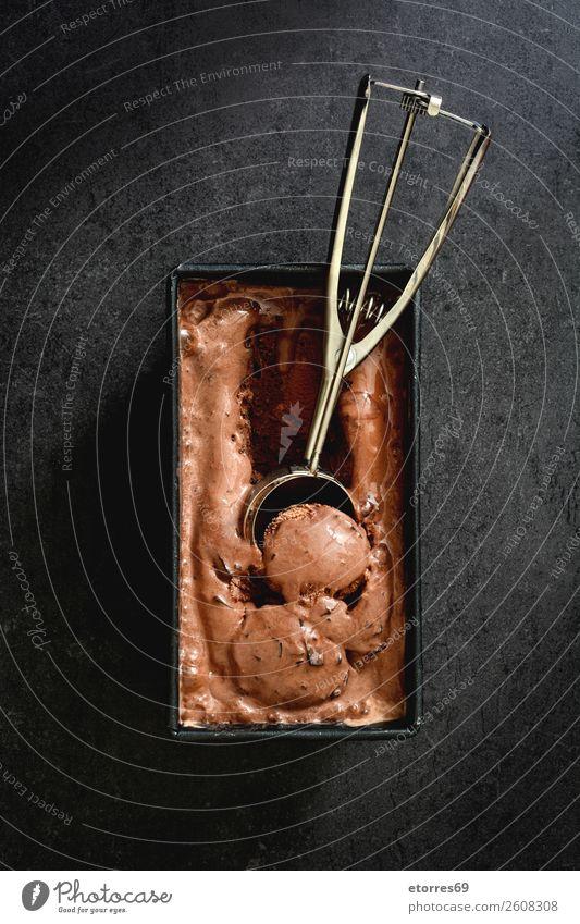 Chocolate ice cream on black stone background Ice cream Sweet Candy Summer Cream Scoop Neutral Background Dessert Frozen Rich Cold Rich in calories Brown