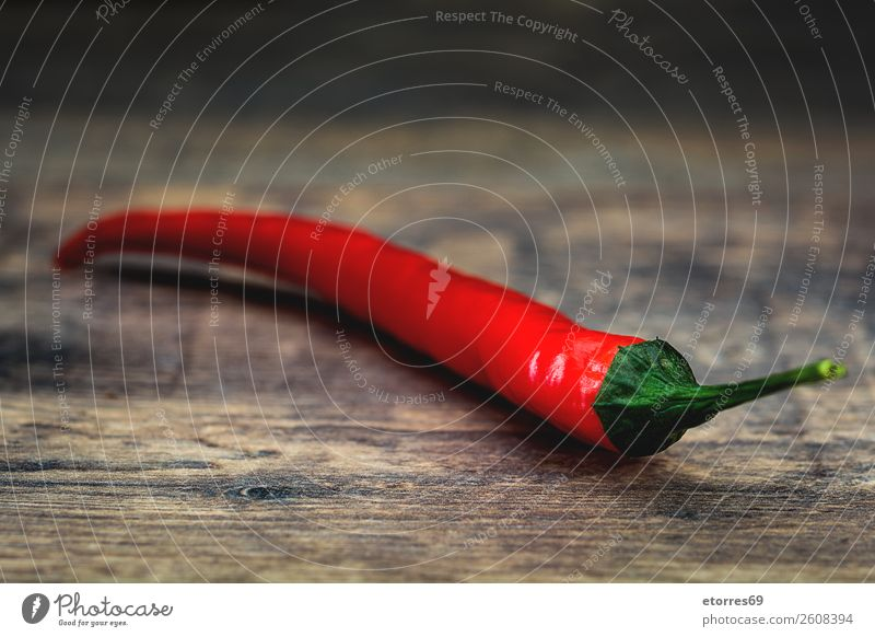 Red chili pepper on wooden table Pepper Chili Spicy Vegetable Food Healthy Eating Food photograph Chile Herbs and spices Burn Cooking Fresh Hot Ingredients