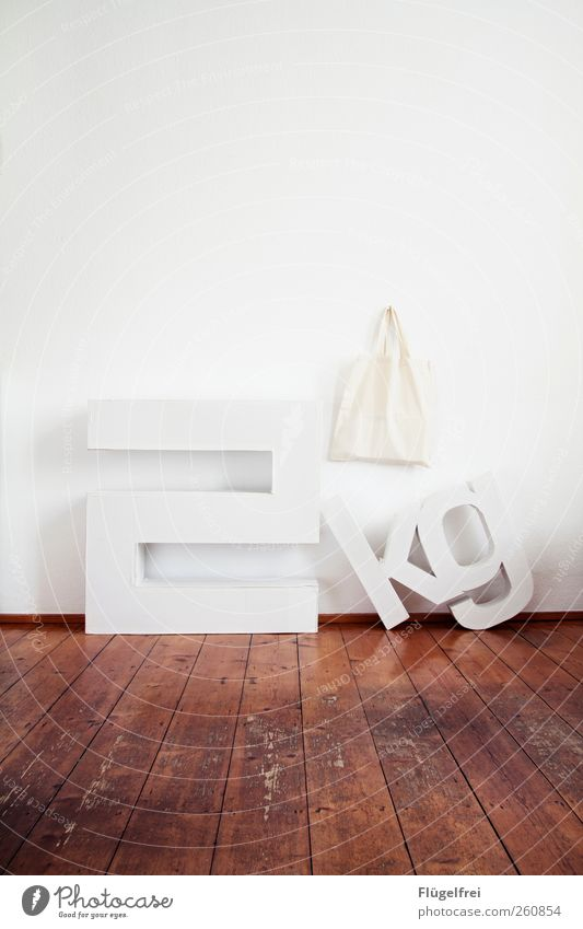 2kg load Art Stand Letters (alphabet) Cardboard Crazy Weight Kilogram jute bag Parquet floor Old building Room Floor covering Bright White Wall (building)