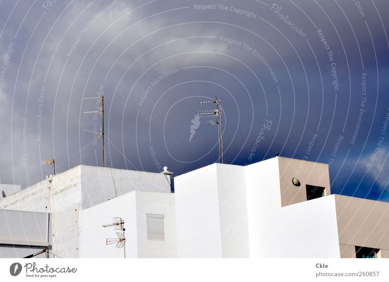 "inhabited Flat (apartment) House (Residential Structure) Antenna Technology Information Technology Architecture Sky Clouds Climate ""Arrecife Lanzarote"" Spain"