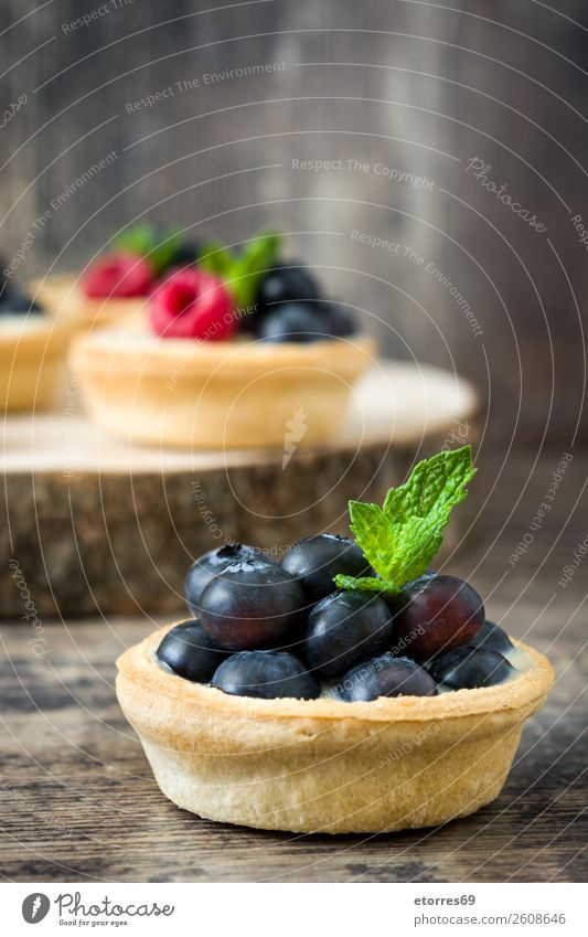 Delicious tartlets with raspberries Tartlet Blueberry Raspberry Fruit Dessert Food Food photograph Healthy Eating Dish Cream custard Snack glazed Baked goods
