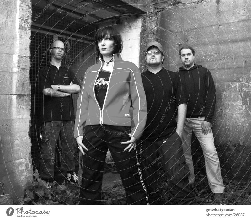 The Band 2 Woman Man Old building Entrance Concrete Cold Earnest Group Black & white photo Perspective Looking Eyes