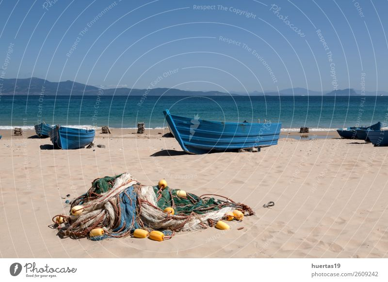 Boats on the beach Relaxation Vacation & Travel Tourism Beach Ocean Sports Sand Coast Boating trip Watercraft Sunglasses Scarf Slippers Hat Work and employment