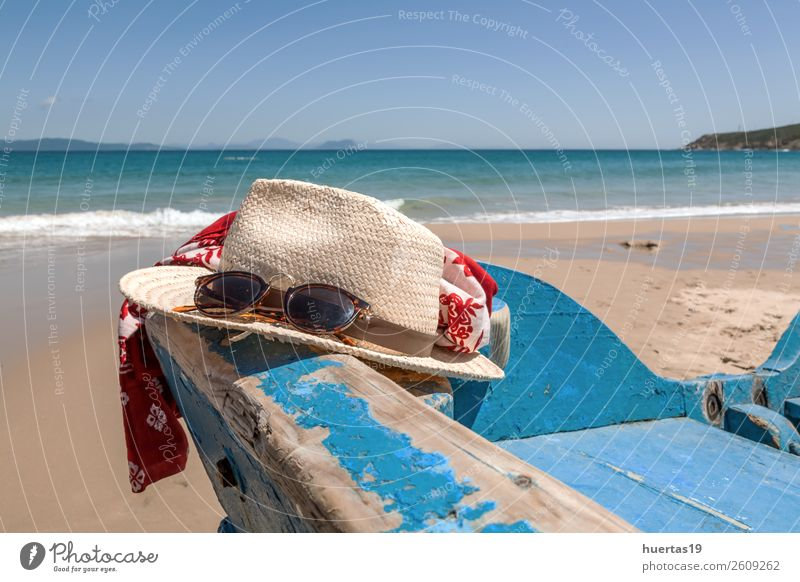Hat and sunglasses on the beach Lifestyle Elegant Style Relaxation Vacation & Travel Tourism Beach Ocean Sports Sand Sun Summer Coast Watercraft Sunglasses