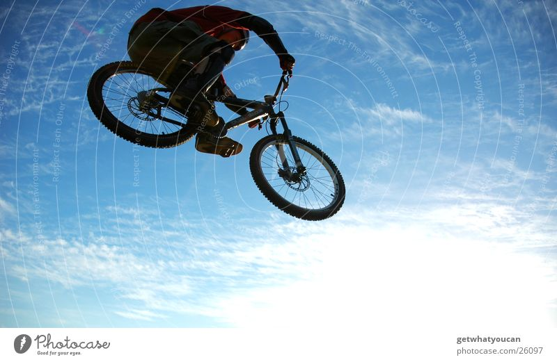 Sky Sun Far-off places Jump Movement Bright Bicycle Tall Brave Helmet Sports ground Extreme sports