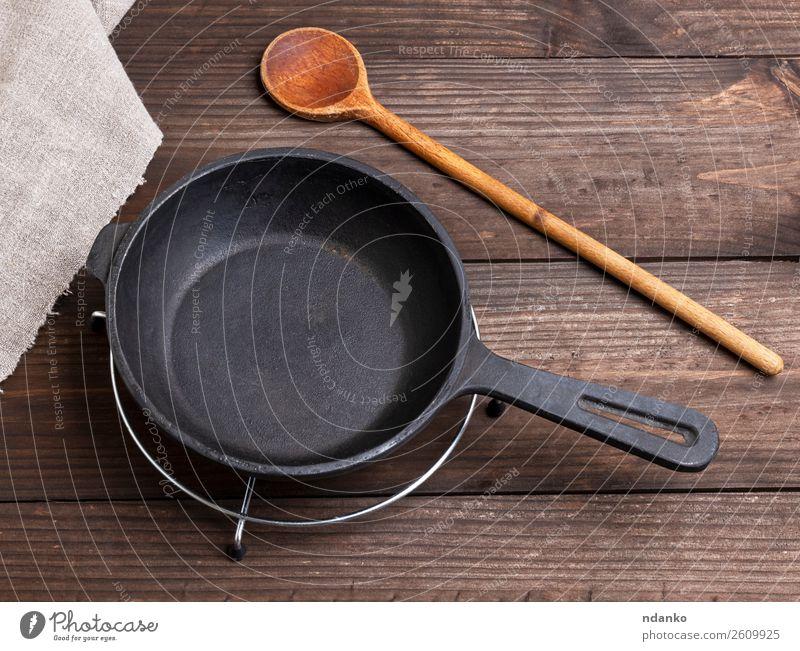 black round cast iron pan Breakfast Dinner Pan Spoon Kitchen Restaurant Metal Steel Stand Retro Brown Black Home empty cooking Preparation skillet Frying food