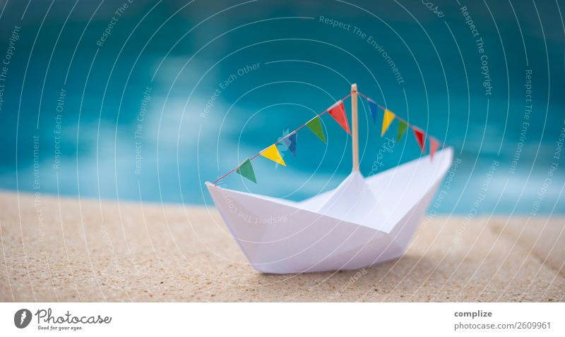 Paper ship with party pennant chain at the water Joy Healthy Life Far-off places Freedom Cruise Summer Summer vacation Sun Beach Ocean Entertainment Party Event
