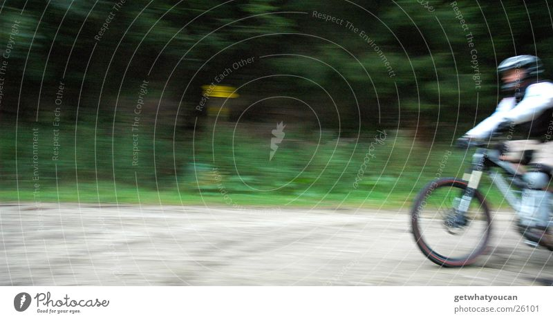 sound barrier Bicycle Speed Forest Helmet Man Blur Gravel Extreme sports Lanes & trails Nature Brave Movement Front side Exterior shot