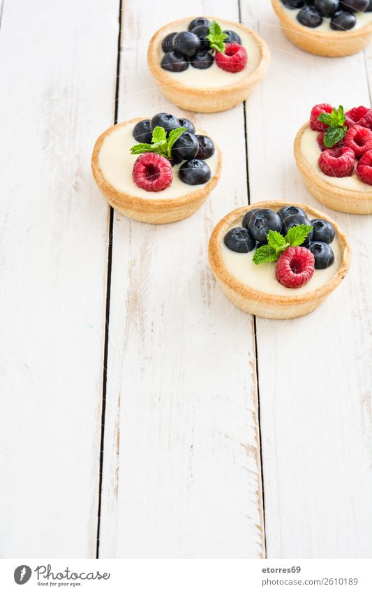 Delicious tartlets Tartlet Blueberry Raspberry Fruit Dessert Food Food photograph Healthy Eating Dish Cream custard Snack glazed Baked goods Home-made Sweet
