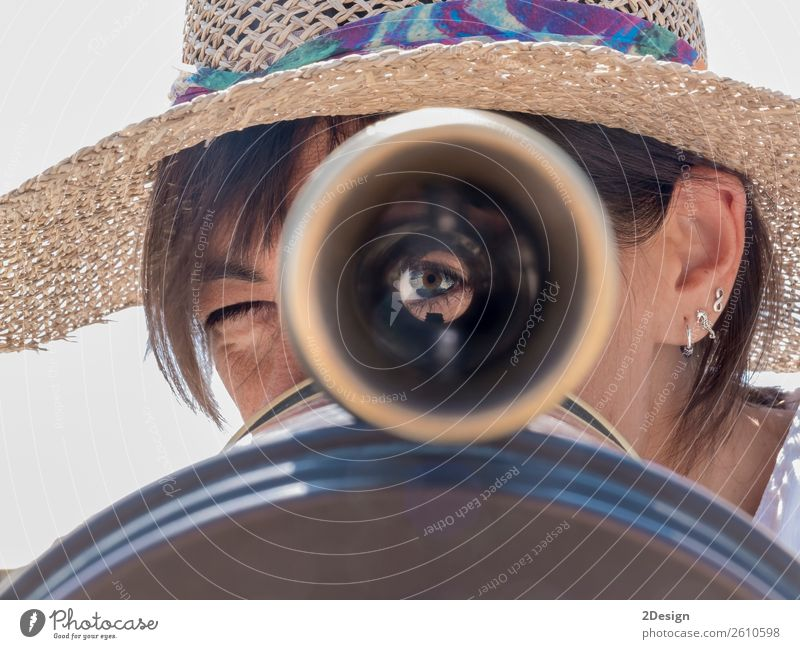 Woman using a binoculars in the city looking to you Beautiful Vacation & Travel Tourism Trip Human being Feminine Young woman Youth (Young adults) Adults 1