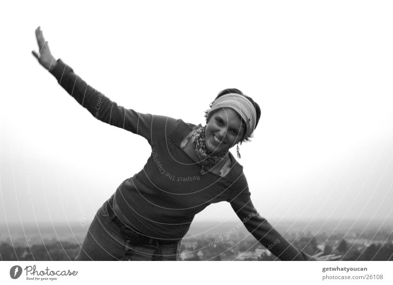 jet fighter Woman Fidget Headscarf Meadow Hill Village House (Residential Structure) Blur Black & white photo Funny Legs Mountain Lawn Laughter Flying Arm
