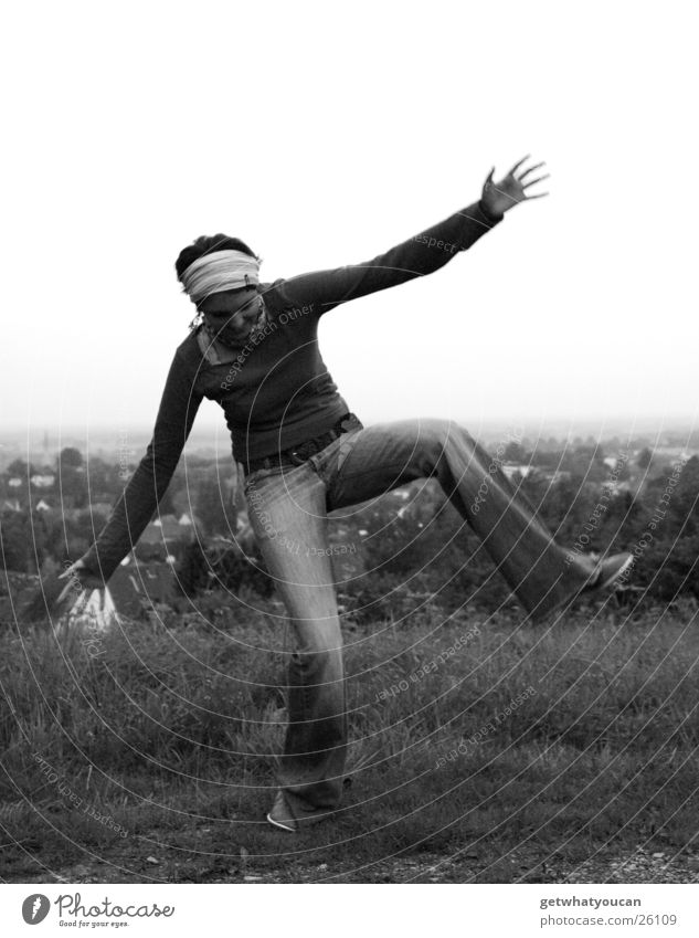 jumping jack Woman Fidget Headscarf Meadow Hill Village House (Residential Structure) Blur Black & white photo Funny Legs Mountain Lawn