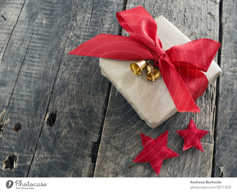 A gift with ribbons and bells Style Winter Christmas & Advent Anticipation Joy golden merry new nobody plank present red rustic season seasonal space Starling