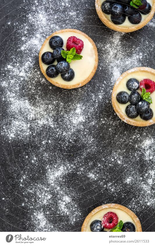 Delicious tartlets with raspberries and blueberries Tartlet Blueberry Raspberry Fruit Dessert Food Dish Food photograph Cream custard Snack glazed Baked goods