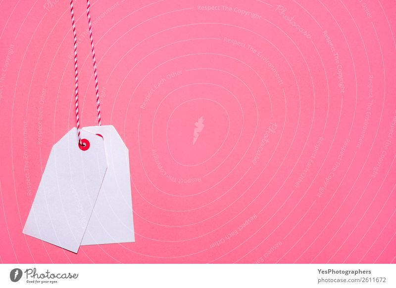 Unwritten white tags on a pink background Shopping Christmas & Advent Paper Sell White Price tag Black Friday backdrop Blank christmas Conceptual design context