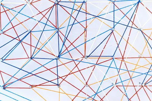Colored threads are stretched on pins on white background Design Decoration Logistics Technology Internet Art Paper Line Modern Smart White Perspective