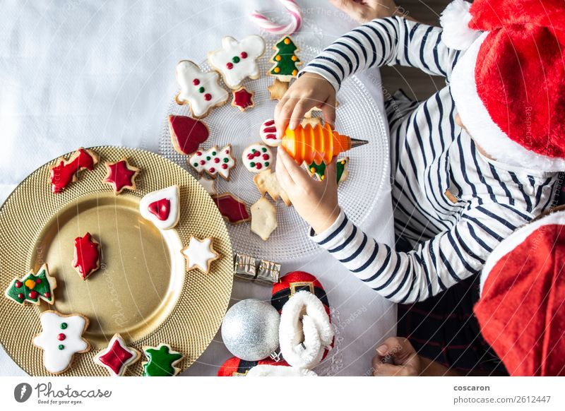 Mother and son decorating Christmas biscuits at home Cake Dessert Candy Lifestyle Joy Happy Beautiful Winter House (Residential Structure) Decoration Kitchen