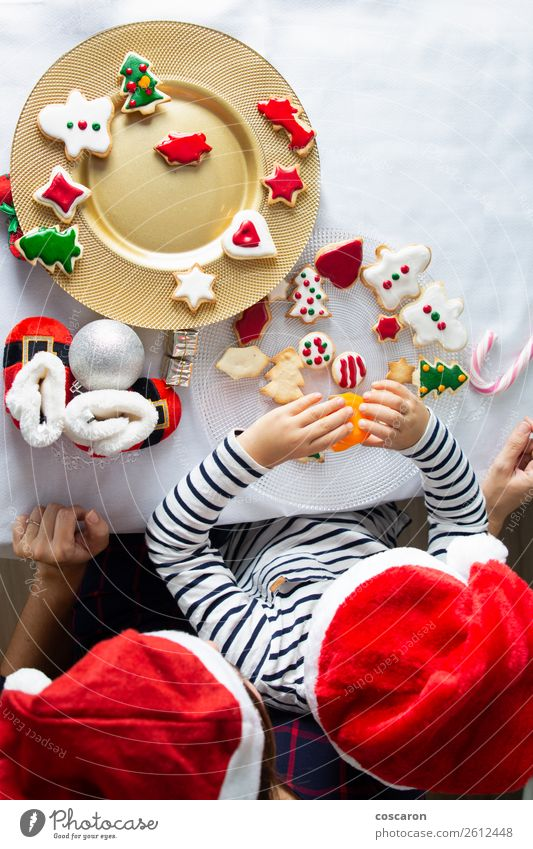 Mother and son decorating Christmas biscuits at home Cake Dessert Candy Lifestyle Joy Happy Beautiful Leisure and hobbies Children's game Winter
