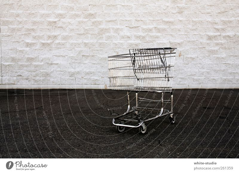 There's nothing in my trolley Shopping Stone Trashy Gloomy Luxury Capitalism Consumption consumer society Shopping Trolley Poverty Pavement Street Tramp
