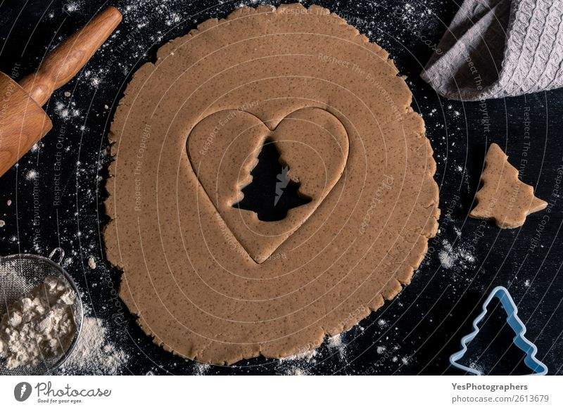 Gingerbread batter on black wooden table Christmas & Advent Winter Lifestyle Feasts & Celebrations Kitchen Tradition Baked goods Cooking Christmas tree Sugar