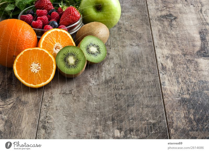 Mixed fruits on a rustic wooden table Fruit Diet Fresh Colour Multicoloured Dessert Neutral Background Sweet Lemon Organic Raw Food Healthy Eating