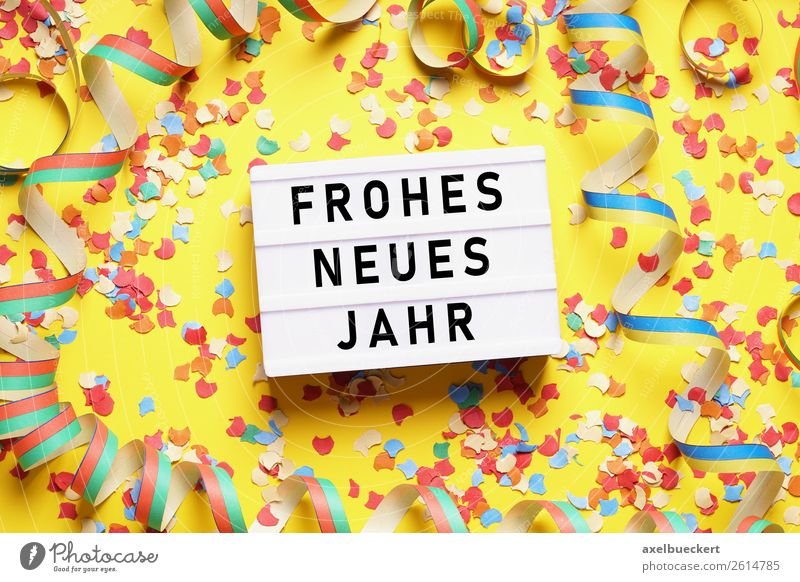 Happy New Year with confetti and streamers Lifestyle Leisure and hobbies Party Event Feasts & Celebrations New Year's Eve Yellow happy new year Confetti