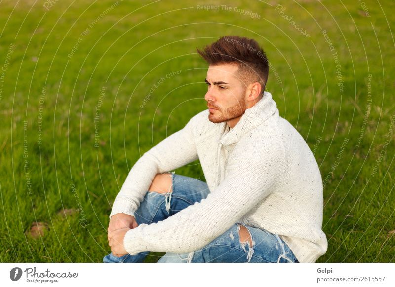 Attractive guy with beard in a green meadow Lifestyle Style Human being Boy (child) Man Adults Landscape Grass Meadow Fashion Beard Think Cool (slang) Eroticism