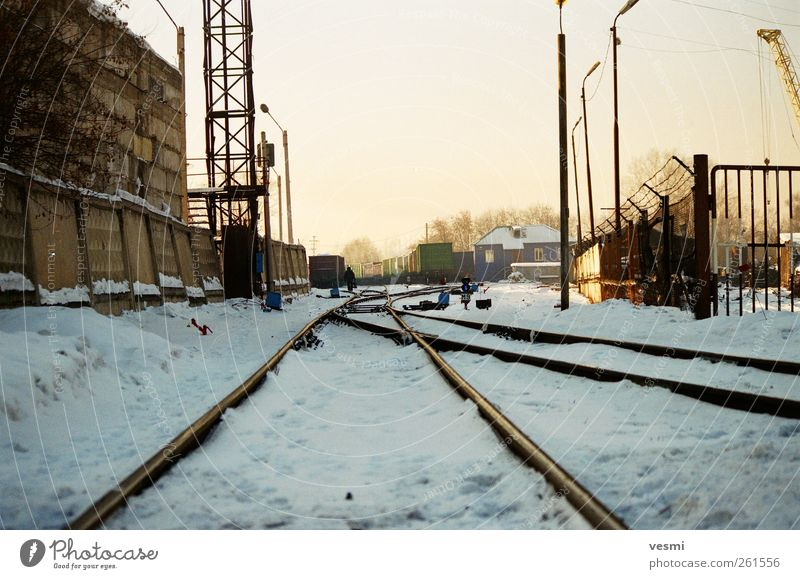 pathworthy Logistics Railroad Freight train Railroad tracks Cold Winter Industrial Industrial site Lantern Concrete wall Colour photo Exterior shot Deserted Day