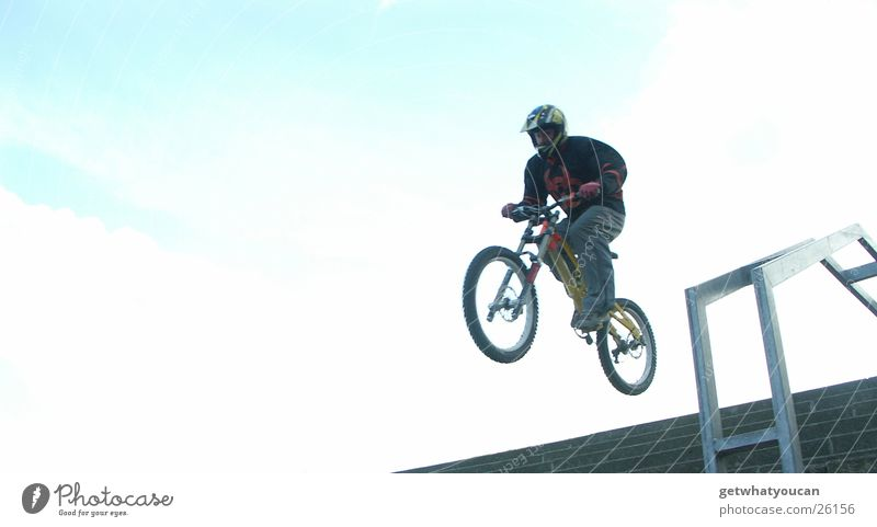 Jump on stairs Bicycle Man Helmet Brave Horizon Protective equipment Speed Far-off places Back-light Extreme sports Stairs Handrail Tall Bright Blue Flying