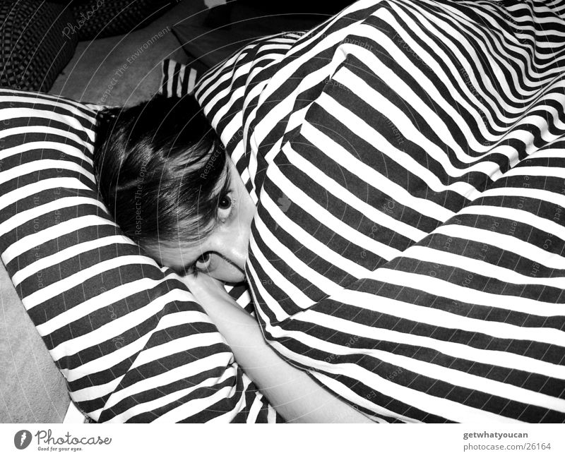 Woman Girl Eyes Hair and hairstyles Head Warmth Arm Nose Bed Near Lie Physics Stripe Cute Hide Safety (feeling of)