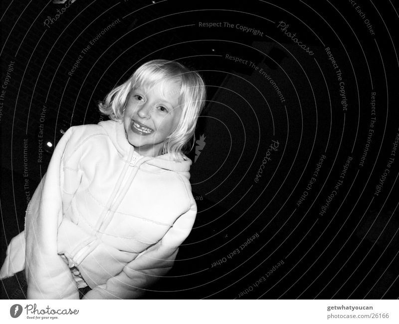 Bright joy Girl Blonde Dark Night Cute Beautiful Coat White Child Laughter Garden Joy Hair and hairstyles Dynamics Movement Teeth