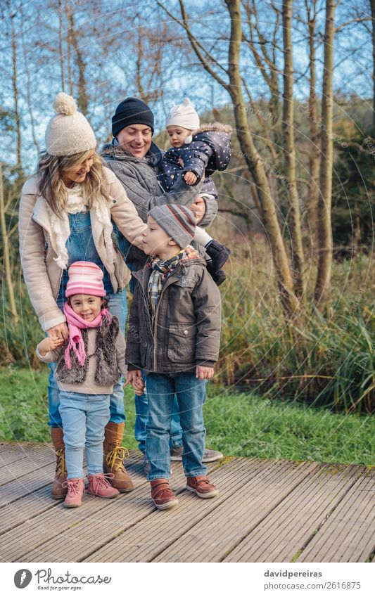 Happy family enjoying together leisure in the forest Woman Child Nature Man Green Hand Tree Joy Forest Winter Lifestyle Adults Wood Autumn Environment Love
