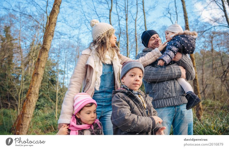 Happy family enjoying together leisure in the forest Lifestyle Joy Leisure and hobbies Winter Child Boy (child) Woman Adults Man Parents Mother Father Sister