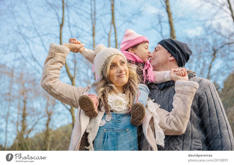 Happy couple with daughter in the forest Lifestyle Joy Leisure and hobbies Winter Child Woman Adults Man Parents Mother Father Family & Relations Couple Hand