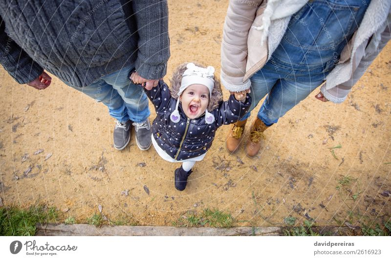 Man and woman holding hands of happiness little girl Lifestyle Joy Happy Winter Child Baby Woman Adults Parents Mother Father Family & Relations Couple Nature