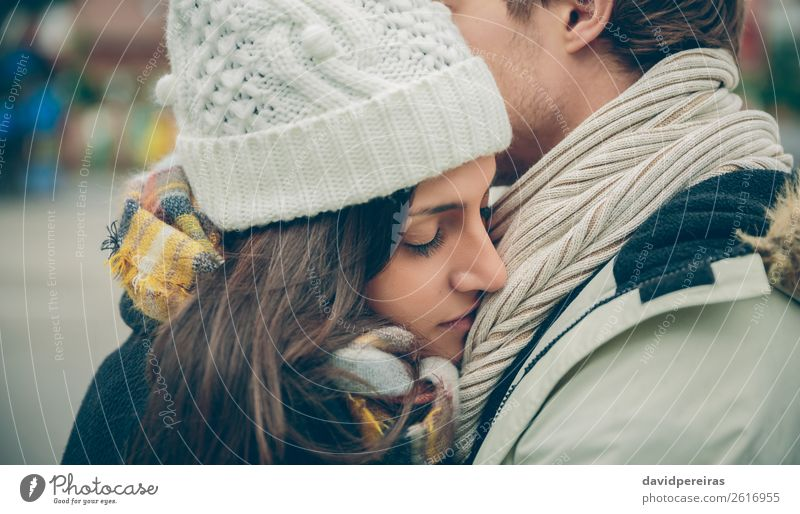Young couple embracing outdoors in a cold autumn day Lifestyle Happy Beautiful Winter Human being Woman Adults Man Family & Relations Couple Autumn Rain Street