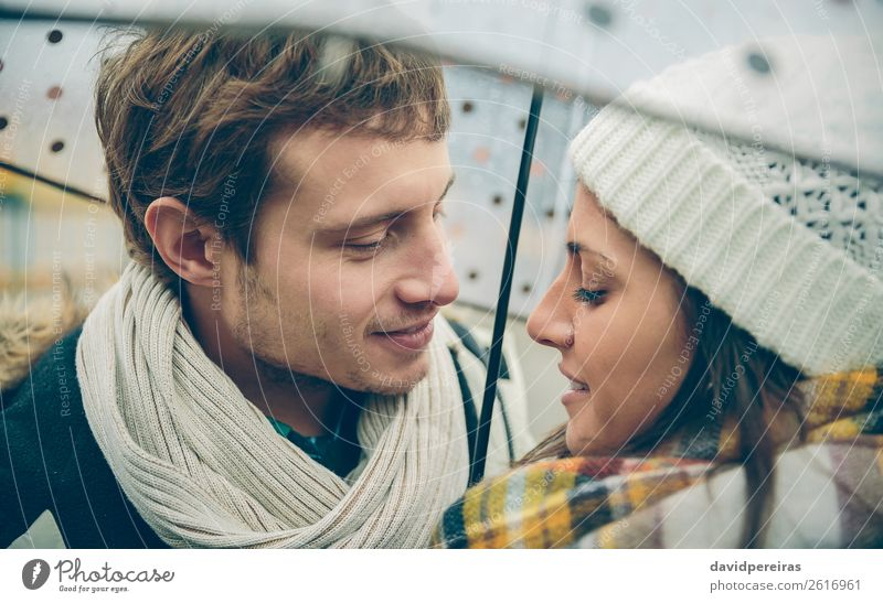 Couple under the umbrella in autumn rainy day Lifestyle Happy Winter Human being Woman Adults Man Family & Relations Autumn Rain Street Scarf Hat Kissing
