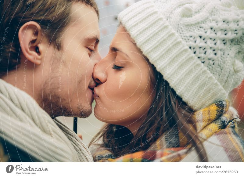 Young couple kissing in autumn rainy day Lifestyle Beautiful Winter Human being Woman Adults Man Family & Relations Couple Lips Autumn Scarf Hat Kissing Love