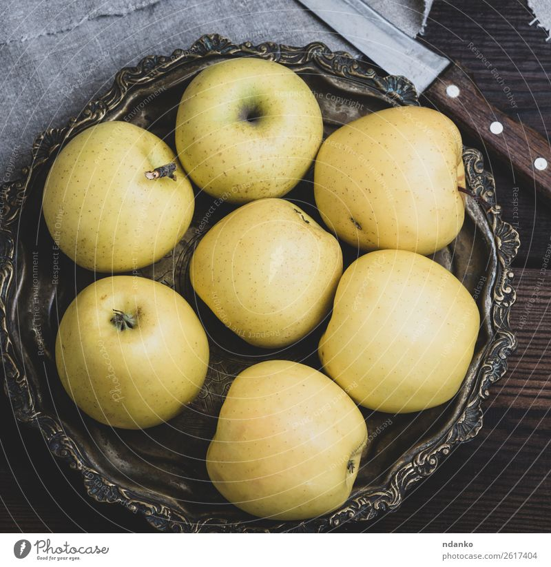 ripe whole yellow apples Fruit Apple Dessert Nutrition Vegetarian diet Diet Juice Plate Knives Table Nature Eating Fresh Yellow Green background healthy food