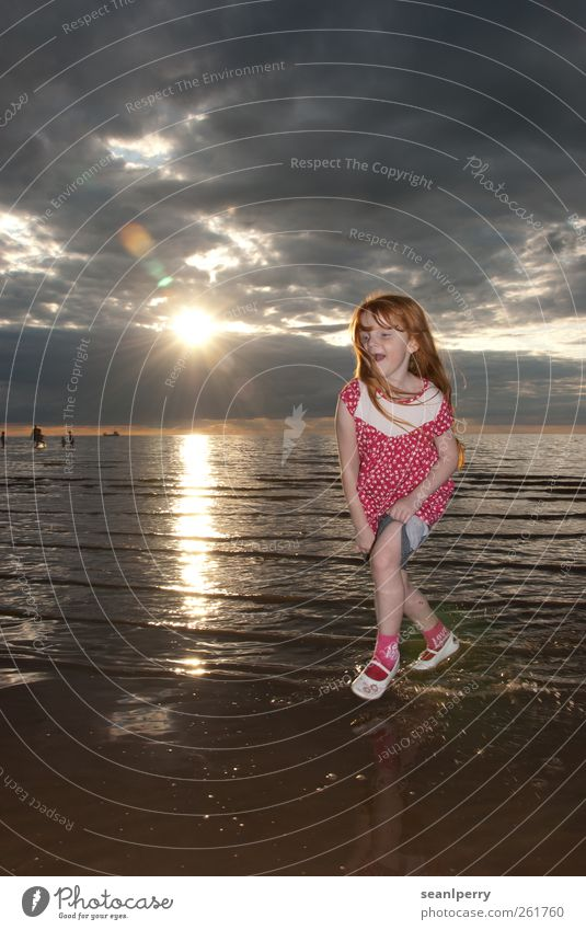 Sunset Paddling Joy Summer vacation Beach Ocean Child Girl 1 Human being 3 - 8 years Infancy Clouds Coast Rolled up Red-haired Laughter Running Happy Pink