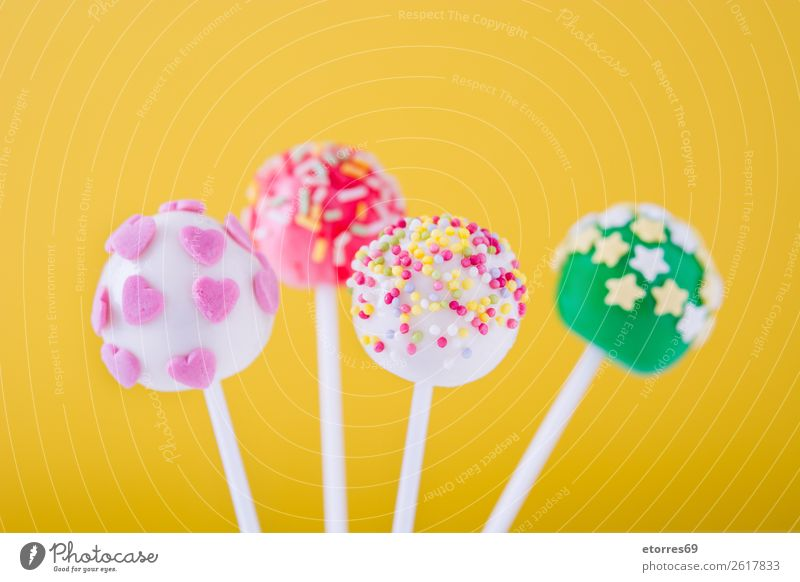 Sweet cake pops on yellow background Colour White Food photograph Joy Yellow Pink Bright Decoration Cake Baked goods Candy Dessert Ball Chocolate
