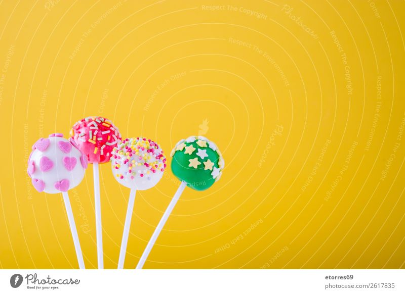 Sweet colorful cake pops on yellow background Colour White Food photograph Joy Yellow Pink Bright Decoration Candy Cake Baked goods Dessert Ball