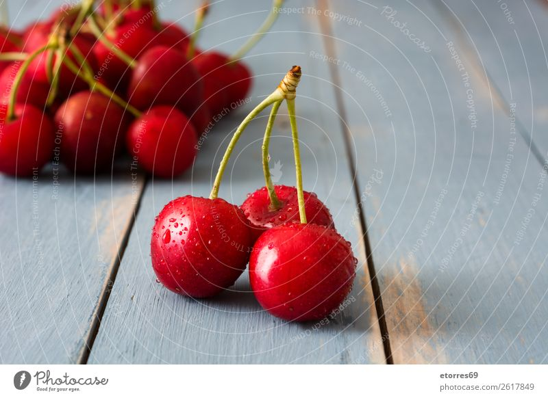 Delicious cherries on a blue wooden table Cherry Fruit Dessert Food Healthy Eating Food photograph Snack Baked goods Home-made Sweet Baking Summer Red Diet