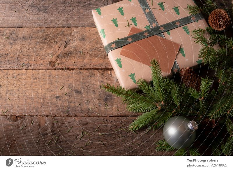 Christmas tree branches and gift on a table Decoration Feasts & Celebrations Christmas & Advent New Year's Eve Green Tradition Christmas balls Merry Christmas