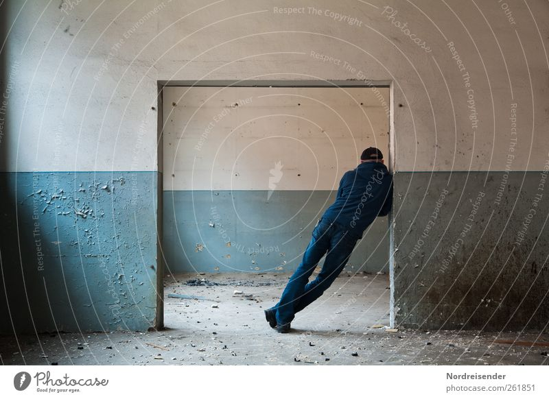 tilted position Lifestyle Human being Masculine Man Adults 1 Ruin Building Architecture Wall (barrier) Wall (building) Door Jeans Cap Line Communicate Stand