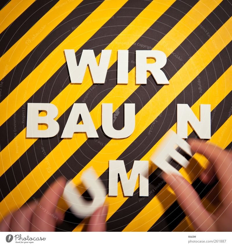 ... in progress Design Construction site Hand Fingers Characters Signage Warning sign Stripe Movement Funny Yellow Black White Idea Creativity Striped