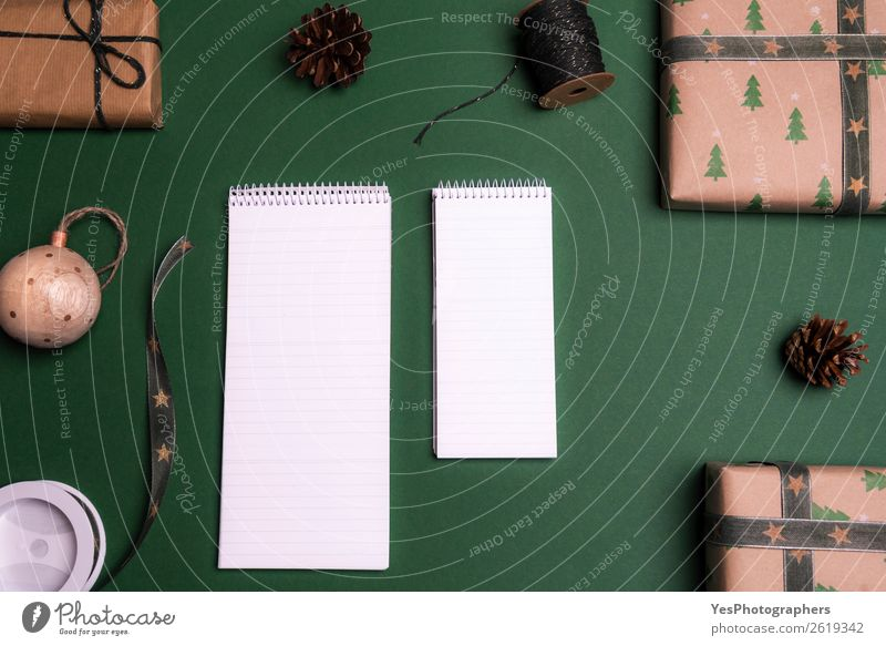 Empty notebooks surrounded by gifts Elegant Happy Winter Decoration Desk Table Christmas & Advent String Brown above view Blank christmas christmassy Classic
