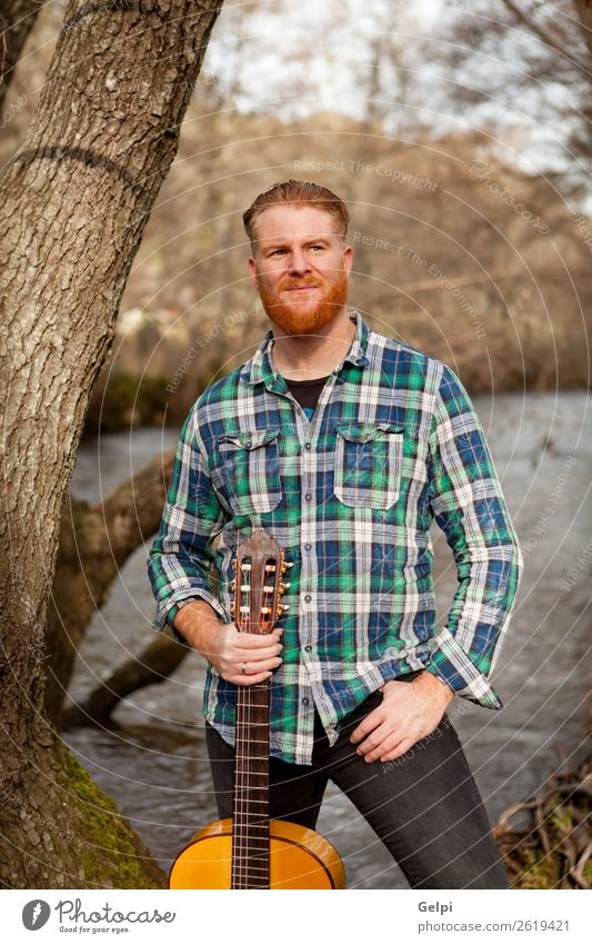 Red haired man Leisure and hobbies Playing Entertainment Music Human being Man Adults Musician Guitar Nature Tree River Red-haired Moustache Cool (slang)